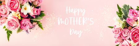 Happy Mothers Day words. Beautiful and tender bouquet of flowers in the hat box, nice present concept, banner size