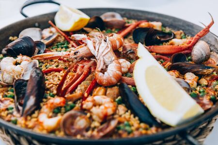 Very tasty seafood paella in the frying pan, traditional spanish food