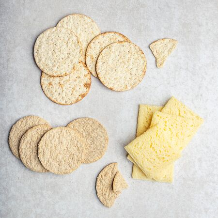 Variety of different Healthy Gluten Free Snacks such as oatcakes, sea salt and pepper crackers, rice crispbreads