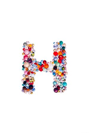 Letter H made from beautiful glass bright gems or crystals on isolated white background