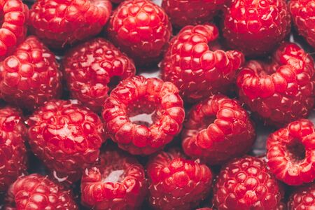 Close up image of fresh raspberries, summer concept, background image from above, food flatlay Фото со стока