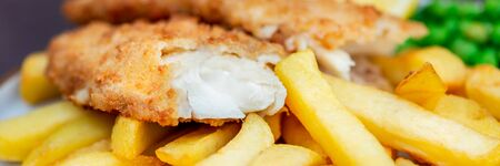 Traditional English Food such as Fish and Chips with green peas served in the Pub or Restaurant