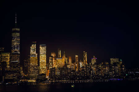 Amazing panorama view on New York City skyline and Downtown Manhattan from Jersey City during night.