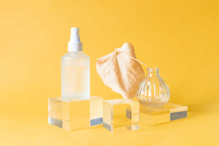 Acrylic Solid Display Blocks for Shop Windows with Mat Bottle and Tiny Vase on bright yellow background