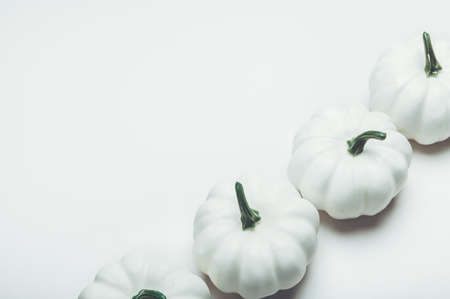 White Pumpkins on light background as minimal autumn concept, flat lay, top view. Halloween or Thanksgiving Holiday backgrounds Stock fotó
