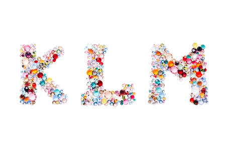 Letter KLM made from beautiful glass bright gems or crystals on isolated white background