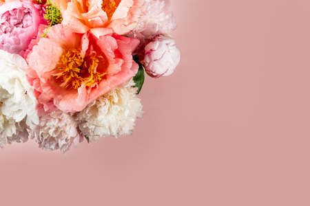 Abundance of Fresh bunch of Peonies Bouquet of different pink colors on light background. Card Concept, copy space for text