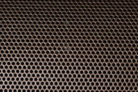 Iron speaker grid texture background.