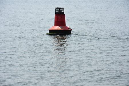 Lonely red buoy in the sea