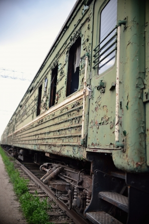 peeled off: Old thrown train cars