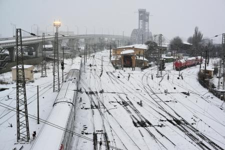 rail cross: Snow-covered railroad