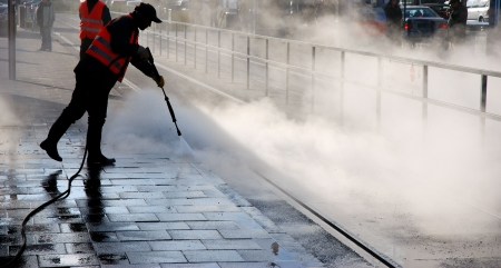 clean street: steam cleaning Stock Photo
