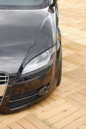 german luxury car on wooden ground