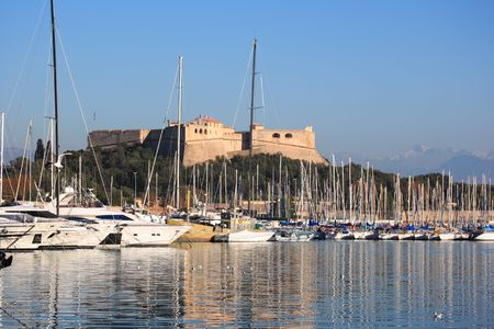french riviera: Antibes harbor and Fort Carre, French Riviera Stock Photo