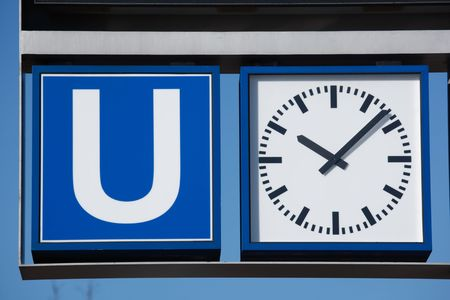 subway sign and clock photo