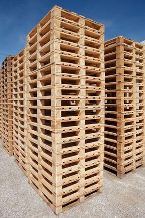 multiple stacks of wooden pallets