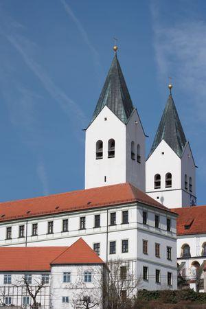 freising: spires freising cathedral, germany, vertical against blue sky