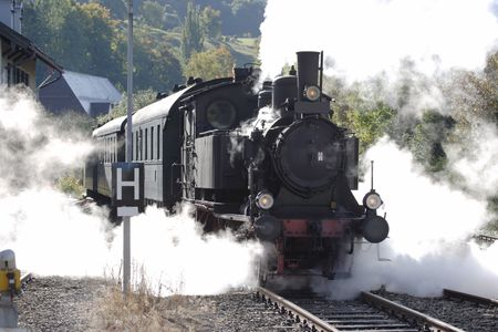 old historic german steam train, back lit, contrast