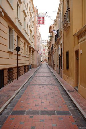 alley with red cobblestone in Monaco, Monte Carlo