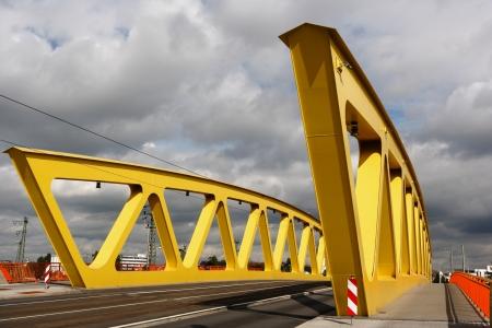 yellow steel bridge, cloudy sky  Mannheim, Germany