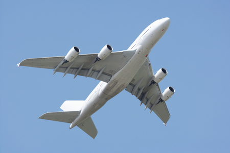 Commercial Airplane fly-by  Clear blue sky  photo