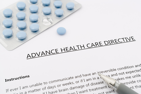 advance health care directive with blue pills to the gray pen