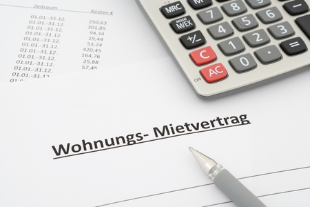 german rental agreement - Mietvertrag Wohnung - in german with calculator and pen Stock Photo