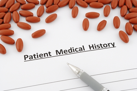 medical history: patient medical history document with pills and pen