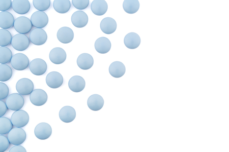 arrangement of blue pills on white background photo
