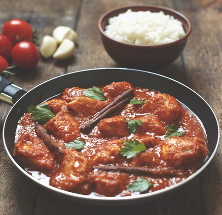 Indian chicken curry traditional food wooden background,