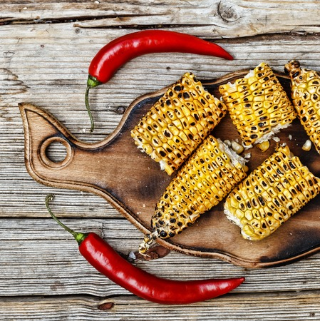 Traditional American food. Grilled corn. top veiw. authentic cuisine Stock Photo
