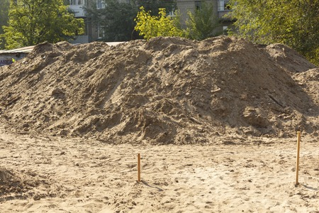 A pile of sand at a construction site. Construction Materials Stock Photo