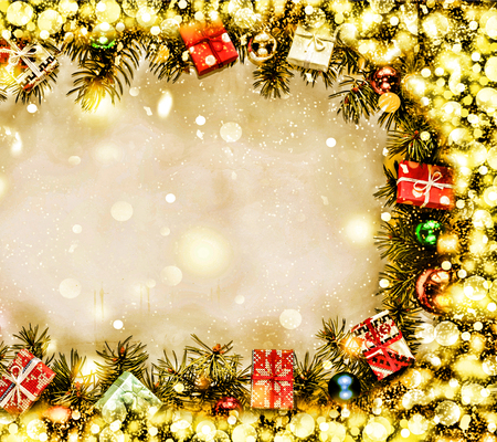 New Year. Background, frame of Christmas tree branches and Christmas decorations. Golden snow. Free space for text.top veiw Stock Photo