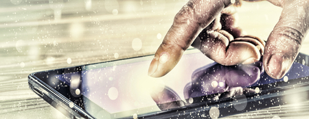Concept: New Year. Finger man or businessman points on a touch screen tablet computer. Luminous screen. Concept: bright idea. a businessman using the touchscreen of a tablet with his hands. close up