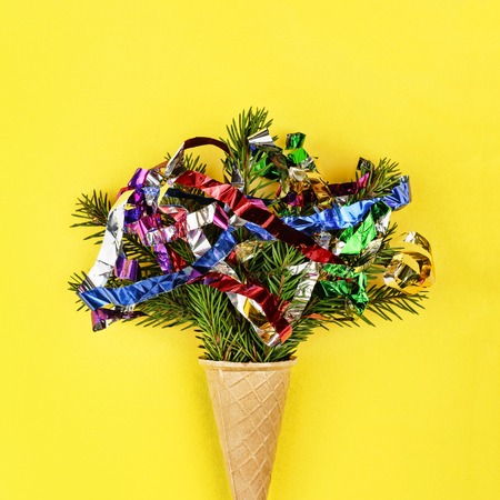 christmas style minimalism new year christmas tree in ice cream cone on a