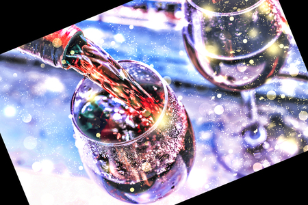 Pouring wine. Christmas wine. Christmas, falling snow, golden snowflakes. New Year. top veiw Stock Photo
