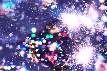New Year Christmas. Abstract background, bokeh, Bengal lights sparkles closeup Stock Photo