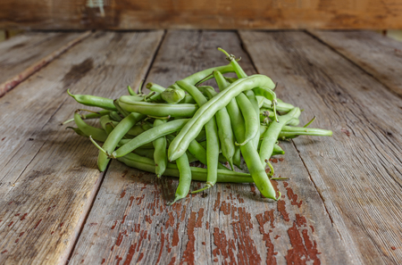 Healthy food. String beans, raw asparagus. Close-up on a wooden table.wooden background Stock Photo