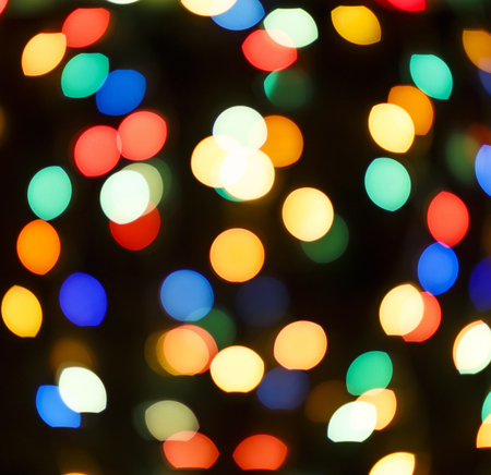Multi-colored bokeh on a black background.Abstract image. Stock Photo