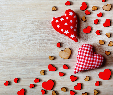Hearts on a wooden background. Valentine's Day background. top view