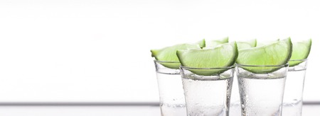 Cocktail with lime. Alcoholic beverage. tequila. A refreshing tonic.close up