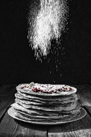 Style noir. Bakery. Fresh bakery. Pancakes. International Pancake Day on 28 February. Russian pancakes, Shrovetide Mardi Gras