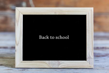 Wooden frame, inscription, black background, Back to school, sch Stock Photo