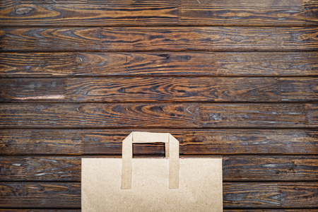 Brown kraft paper bag for shopping on wooden background top view copy space. top view Stock Photo