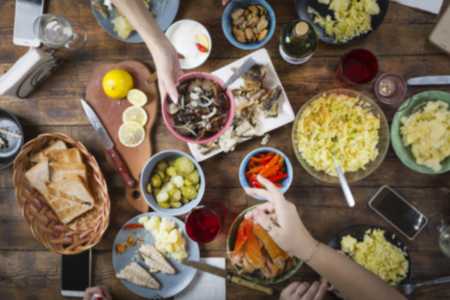 image of dinner table with different food. Easter, Christmas, Birthday, Thanksgiving. Joint toast and blow with a glass of salute in honor of the holiday. top view Stock Photo