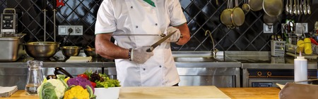 Closeup of a chef sharpening knives in a restaurant kitchen Stok Fotoğraf