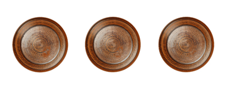 Three empty clay plates isolated on white background. Ancient clay plate on a white background Banco de Imagens