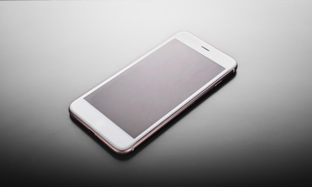 White smartphone on a gradient gray background