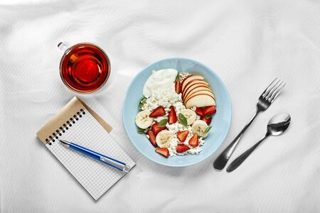 Concept of healthy breakfast and planning business woman's day.