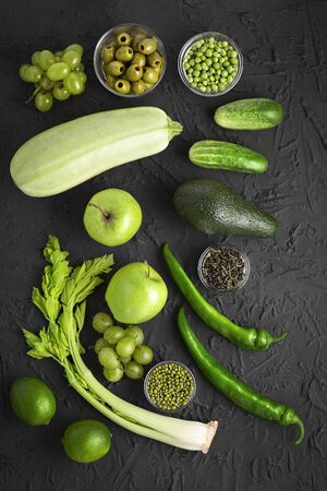 Flat lay of some seasonal green foods that are very healthy. A part of a healthy lifestyle. eco-friendly market. Stock Photo